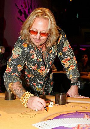 Vince Neil Signs Autograph